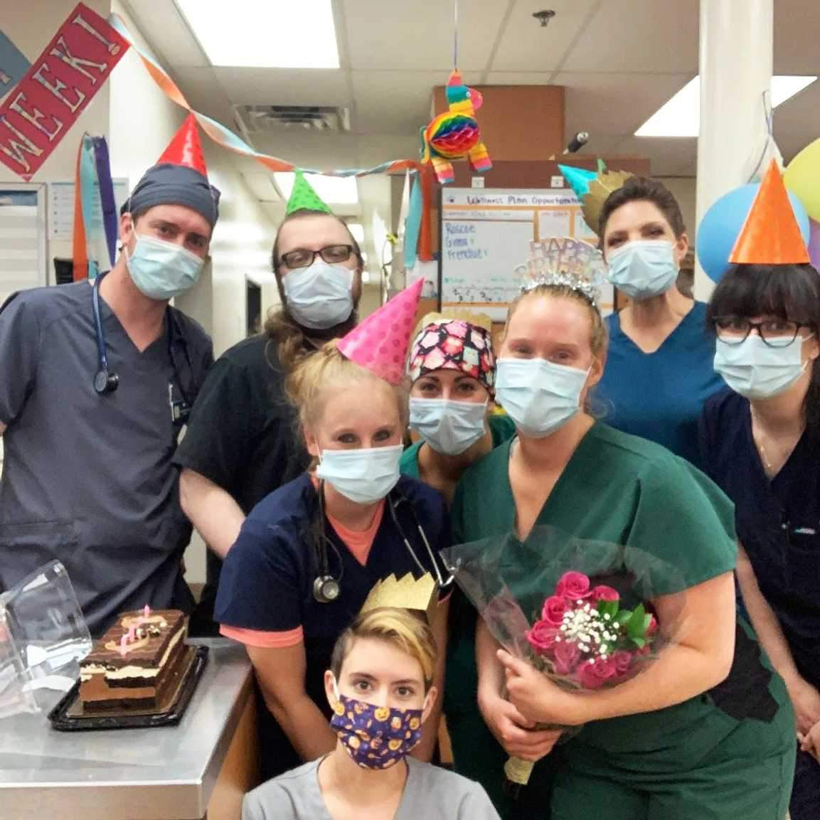 A group of associates celebrating a milestone at the Banfield Pet Hospital
